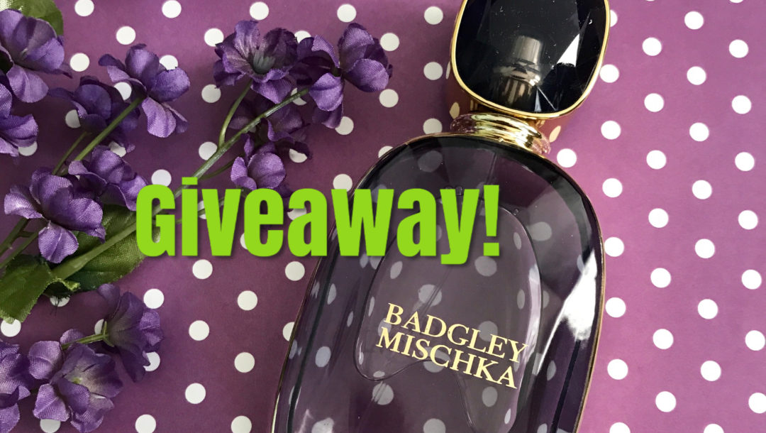 d787698b8 Never Say Die Beauty · purple glass faceted bottle of Badgley Mischka Eau  de Parfum with giveaway written on the photo